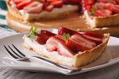 stock photo of tarts  - a piece of strawberry tart on a plate close - JPG