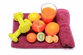 picture of immune  - Fresh fruits glass of juice and green dumbbells for using in fitness lying on purple towel concept for slimming healthy nutrition and strengthening immunity - JPG