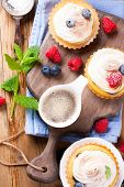 stock photo of curd  - Cup of coffee and delicious homemade tartlets served with lemon - JPG