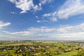 stock photo of slag  - Flat west German landscape near Aachen and Herzogenrath with lots of wind turbines and some clouds on blue sky - JPG