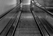stock photo of escalator  - escalators in the city of Milan await the arrival of commuters