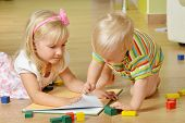 stock photo of little sister  - little boy with his sister playing at home - JPG