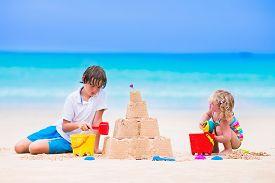 foto of spade  - Kids playing on a beach - JPG