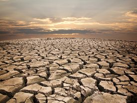 stock photo of drought  - Drought land against sunset background pattern nature - JPG