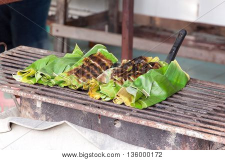 Fish curry in banana leaves grilled by heat on the grill
