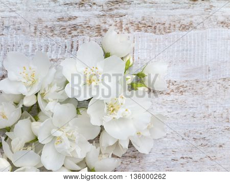 White delicate flowers bouquet in the corner of the rustic background