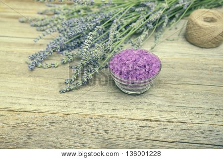 Lavender and sea salt on wooden boards. Still life. Toned photo.
