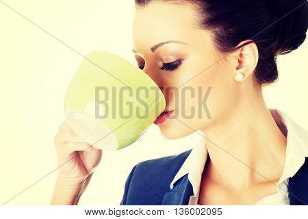 Businesswoman having coffee / tea break