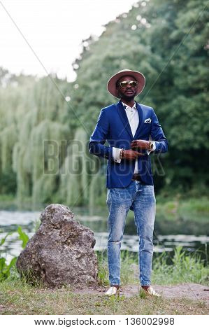 Full Length Portrait Of Stylish Black Man At Jacket, Hat And Sunglasses