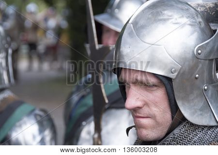 Tewkesbury UK-July 17 2015: Knight in armour marching toward battle on 17 July 2015 at Tewkesbury Medieval Festival