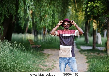 Fashionable And Stylish Black Man With Sunglasses And Hat