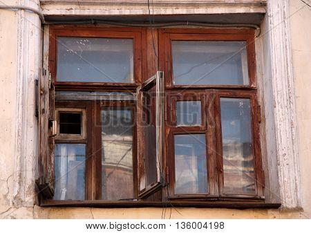 Old house with an antique wooden window