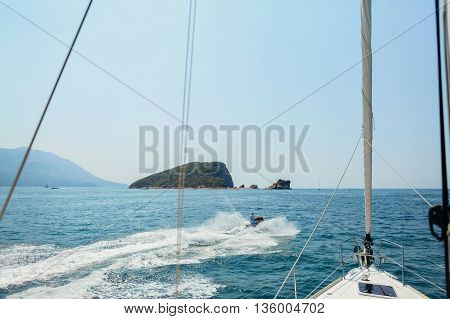 yacht sails in open sea view background