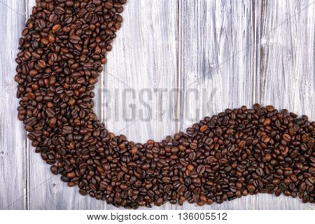 Coffee beans stacked on the white wooden and old background