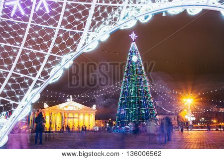 Minsk Belarus - December 19 2015: Christmas tree illuminations and decorations in town Oktyabrskaya Square in central Minsk Belarus