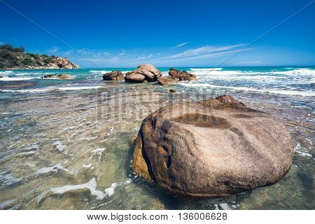 Stone at the beach on the blue sky