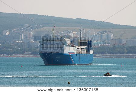 Gelendzhik Russia - September 8 2010: Large ferry boat with trucks on its deck at the sea port