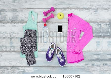 Workout kit on the wooden floor for active people