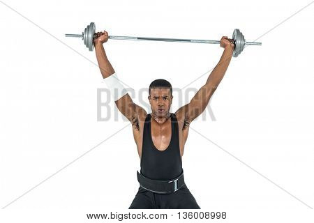 Portrait of bodybuilder lifting heavy barbell weights on white background