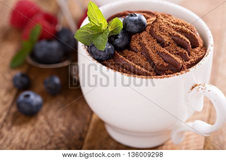Healthy chocolate pudding with cocoa and berries