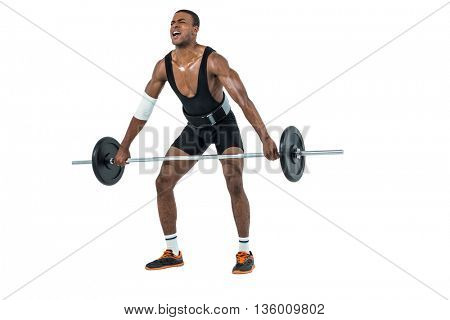 Bodybuilder lifting heavy barbell weights on black background