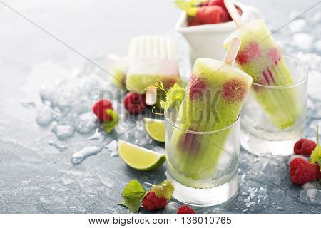 Cucumber lime spa healthy popsicles with fresh raspberries