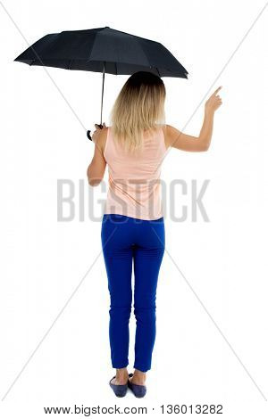 pointing  woman  under an umbrella. Rear view people collection.  backside view of person.  Isolated over white background. The girl under an umbrella stands and shows the left hand ..
