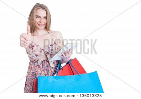 Young Shopper Showing Thumb Up And Browsing On Tablet Pc