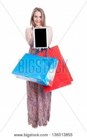 Full Body Of Happy Female Shopper Holding Tablet And Bags