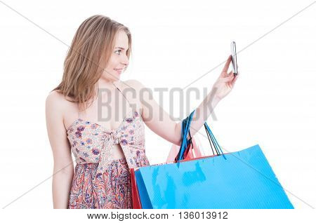 Beautiful Smiling Shopper With Gift Bags Taking A Selfie