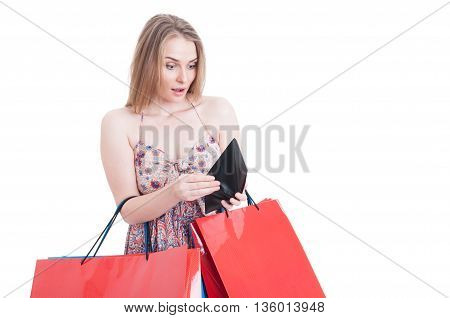 Surprised Female Shopper At Shopping Looking Into Her Wallet