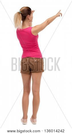 Back view of  pointing woman. beautiful girl. Rear view people collection.  backside view of person.  Isolated over white background. Blonde in brown shorts saw something interesting on the right ..
