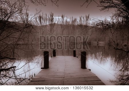 Small jetty on a small lake in a rainless winter