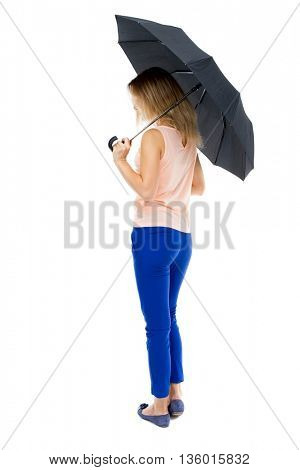 young woman under an umbrella. Rear view people collection.  backside view of person.  Isolated over white background. Blonde girl in blue pants right side is hiding under an umbrella.