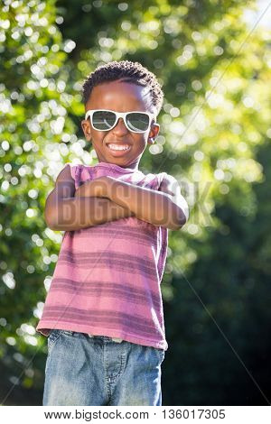 Boy wearing sunglasses crossing his arms