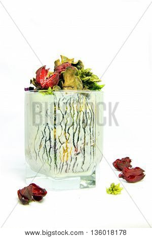 dried flowers in a glass of Kefir yogurt stains white background abstraction still life.