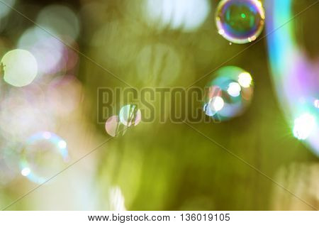 soap bubbles on green background with beautiful bokeh