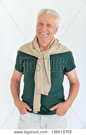 Portrait of a happy senior man on a white background