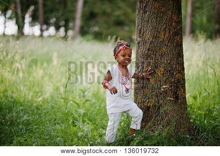 African baby girl walking at green park