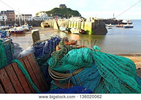 Colourful nets in the working harbour at Ilfracombe North devon UK