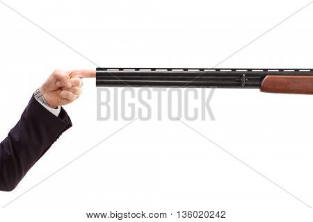 Studio shot of a male finger plugging a barrel of a shotgun isolated on white background