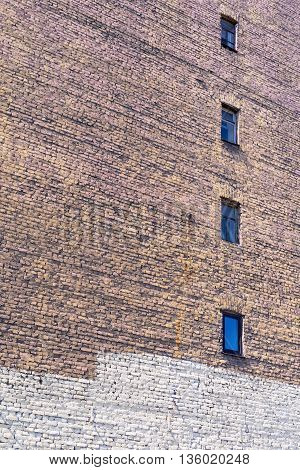 old big brick wall with windows for textured vintage background