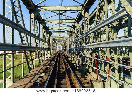 Tailway Train Bridge closeup inside on steel structure crossing .