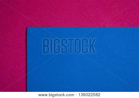 Eva foam ethylene vinyl acetate blue surface on pink sponge plush background