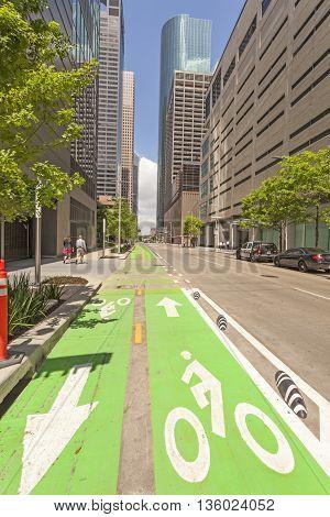 HOUSTON USA - APR 14: Green bikeway in Houston downtown district. April 14 2016 in Houston Texas United States