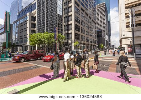 HOUSTON USA - APR 14: People waiting to cross the street in Houston downtown district. April 14 2016 in Houston Texas United States