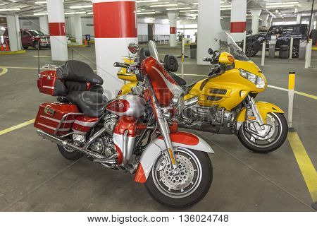 HOUSTON USA - APR 14: Harley Davidson and Honda Goldwing motorcycles in a parking garage. April 14 2016 in Houston Texas United States