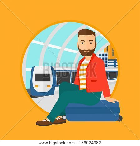 A hipster man with the beard sitting on a suitcase at the train station. Young man waiting for a train at the railway platform. Vector flat design illustration in the circle isolated on background.