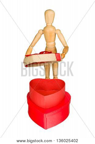 Wooden mannequin opens heart shaped gift box isolated on white