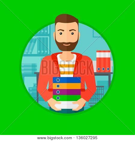 A hipster man standing with pile of folders in the office. Office worker holding folders. Man carrying a stack of folders. Vector flat design illustration in the circle isolated on background.